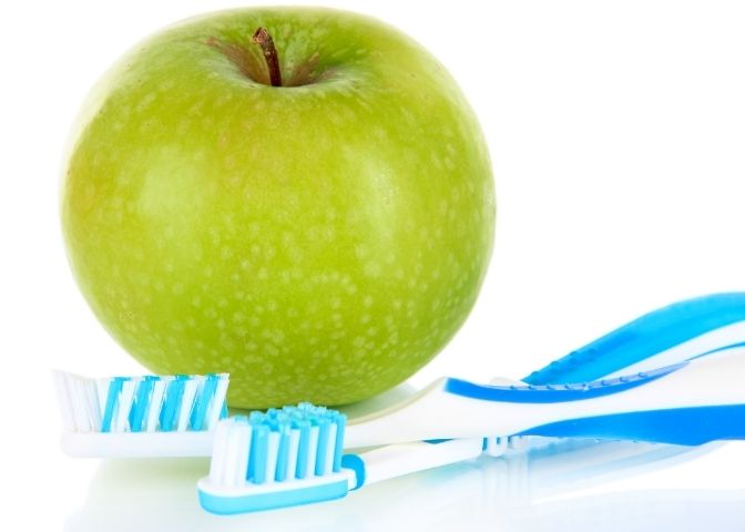 Apple with a Toothbrush