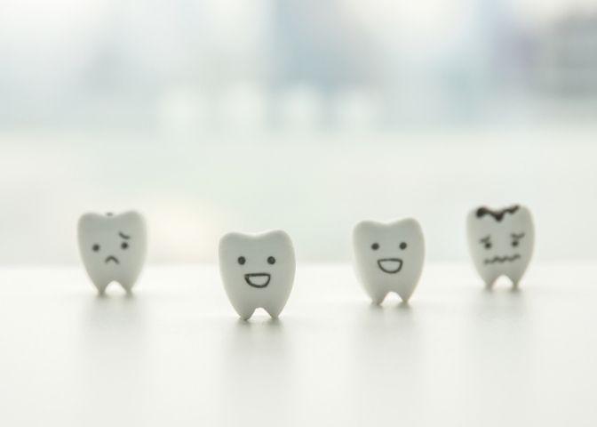 healthy teeth and decayed teeth cartoon